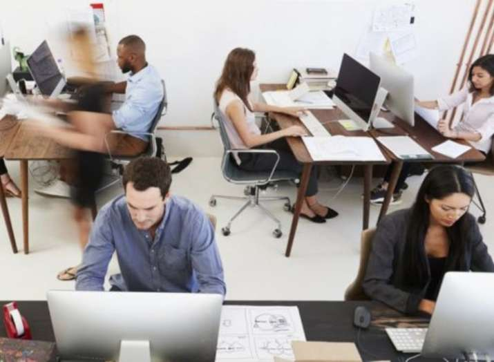 India Tv - Listen up Workaholics! Office workers who sit a lot need to exercise