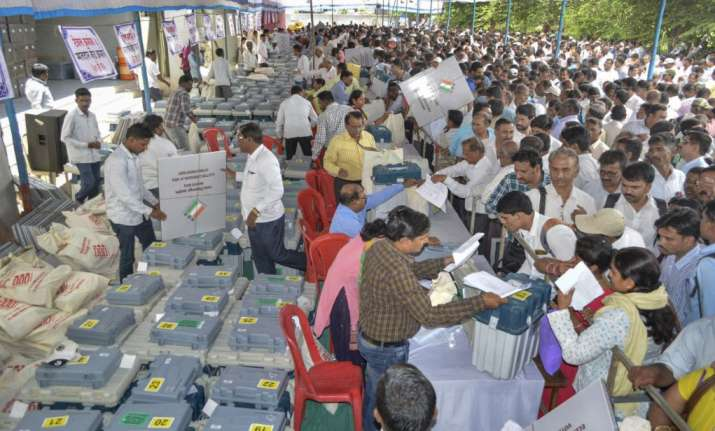 India Tv - Karad: Polling officials collect their EVMs and other election material ahead of the third phase of