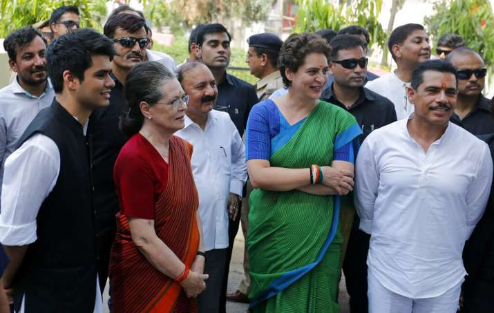 Congress party leader Sonia Gandhi, second left, stands