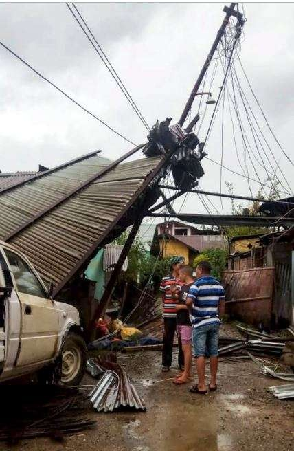 India Tv - Thunderstorm Alert Latest News: People look at the destruction caused by a thunderstorm, in Imphal, Monday, April 15, 2019. The storm claimed three lives and left many injured.
