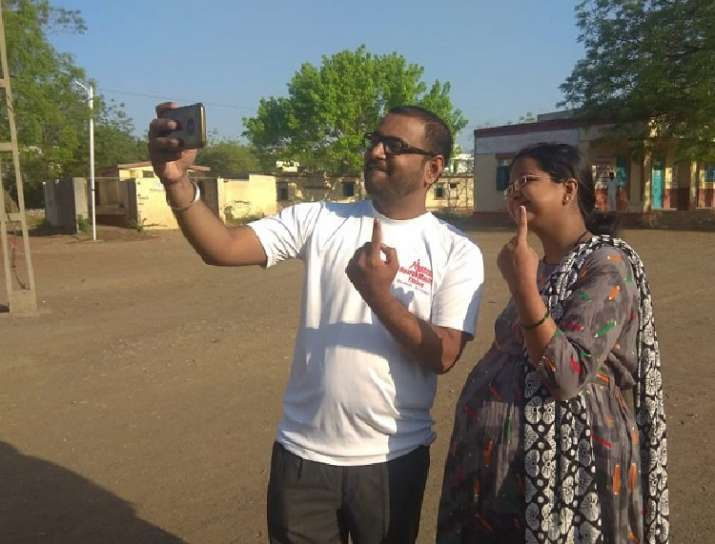 India Tv - Maharashtra: A pregnant woman and her husband, after casting their vote at polling booth in Nehru Nagar of Solapur