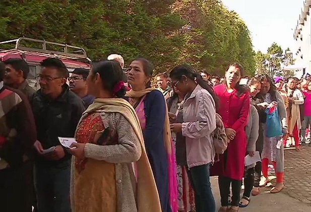 India Tv - West Bengal: People queue outside a polling station in Darjeeling, to vote
