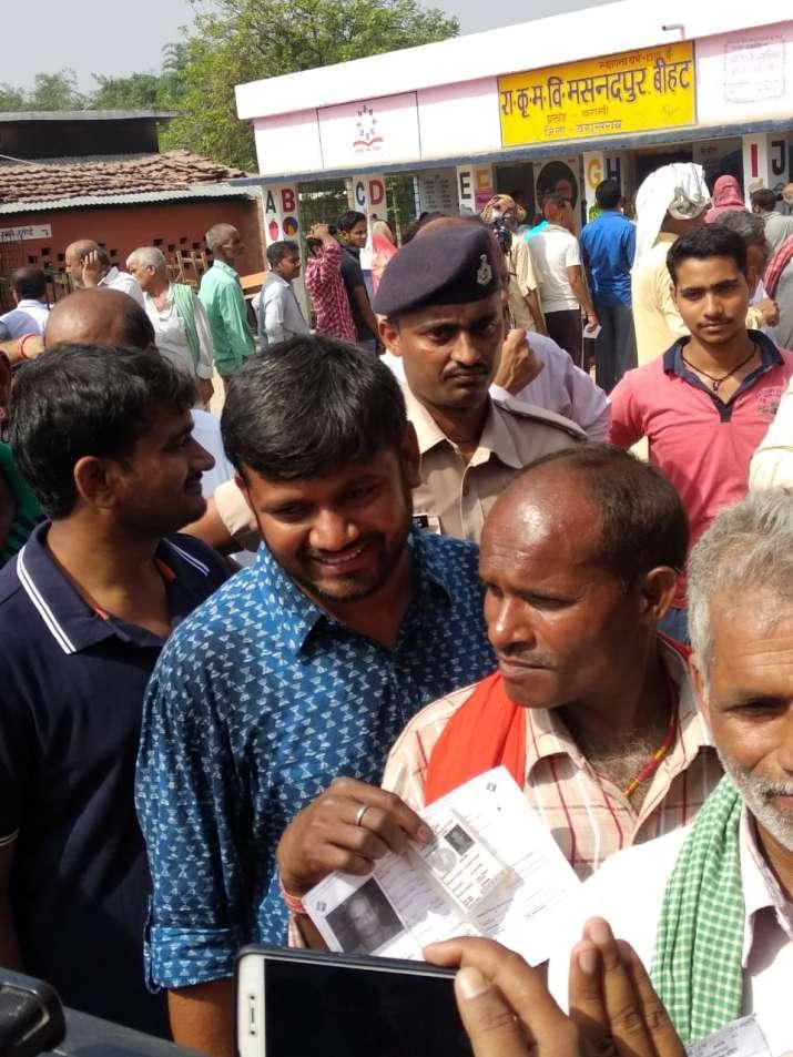 India Tv - Kanhaiya Kumar standing in queue at a polling booth in Begusarai