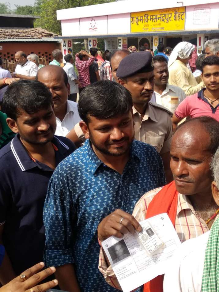India Tv - Kanhaiya Kumar standing in a queue at a polling booth in Begusarai