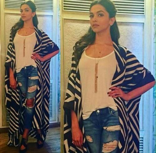 India Tv - Deepika Padukone's black and white shrug