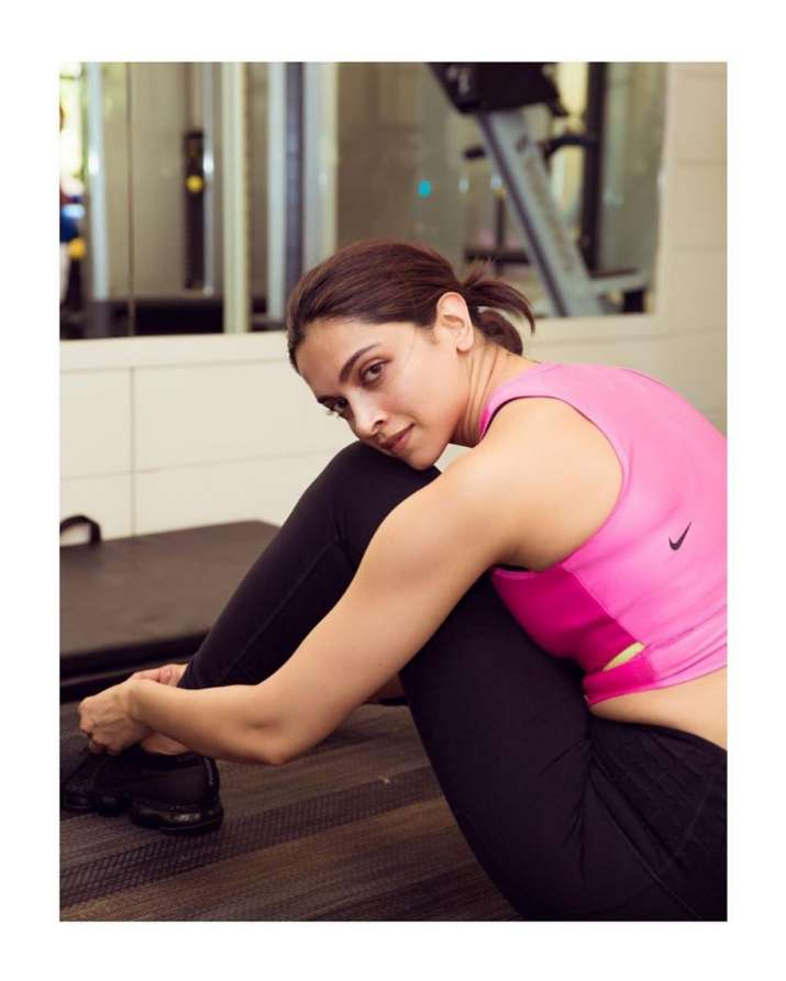 India Tv - Deepika Padukone looks stunning in pink and black activewear.