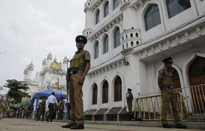 Sri Lankan police officers stand guard outside a Sufi
