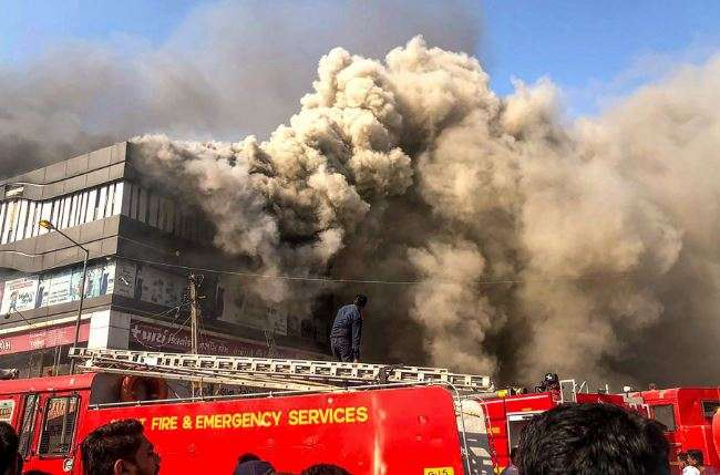 Fire engulfs Surat building, students jump off floors