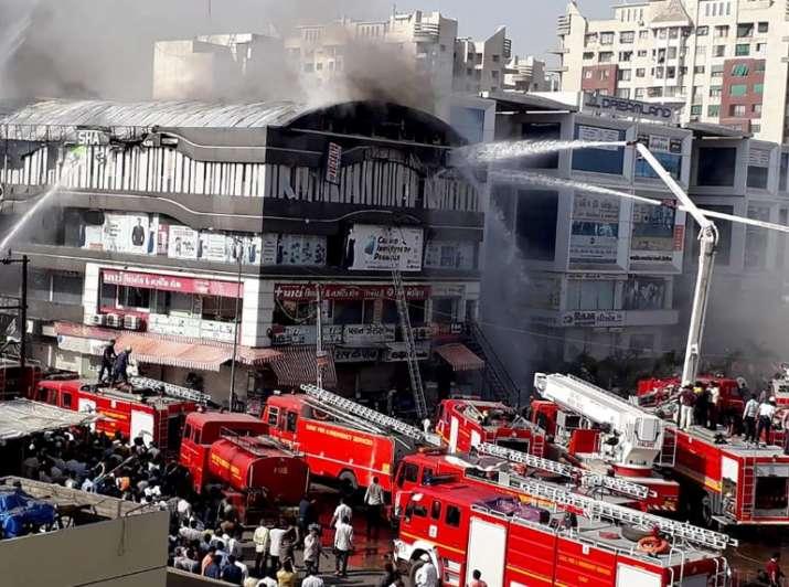 India Tv - Fire engulfs Surat building, students jump off floors