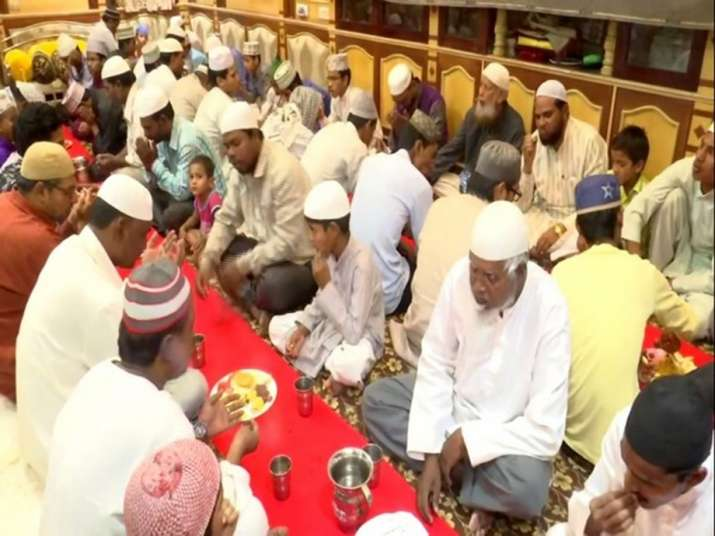 People enjoying iftar at Zaheer Uddin Khan Memorial Trust