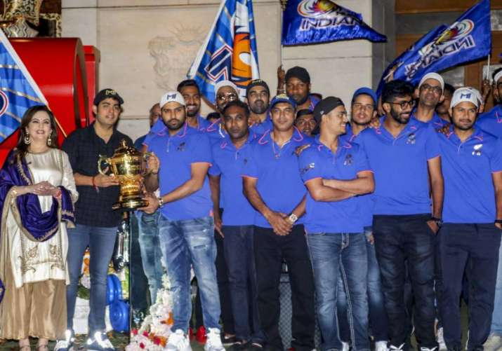India Tv - Mumbai Indians players and owners pose with the IPL title