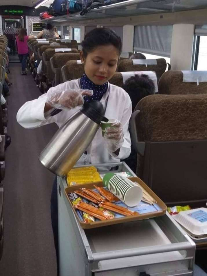 India Tv - Railway steward at Vande Bharat Express serving tea.