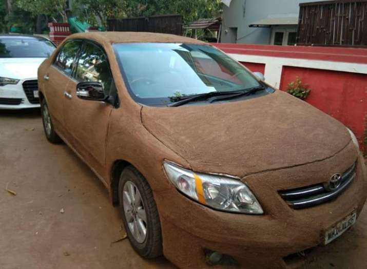 Ahmedabad woman covers her car with cow dung to keep it cool