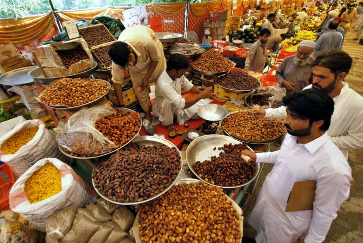 India Tv - A man buys dates, a favorite food for Muslims for 'iftar', the meal to break their fast, from a government-run bazaar specially set up for fasting month of Ramadan, in Rawalpindi, Pakistan, Tuesday, May 7, 2019. Muslims around the world are observing Ramadan, the holiest month in Islamic calendar.