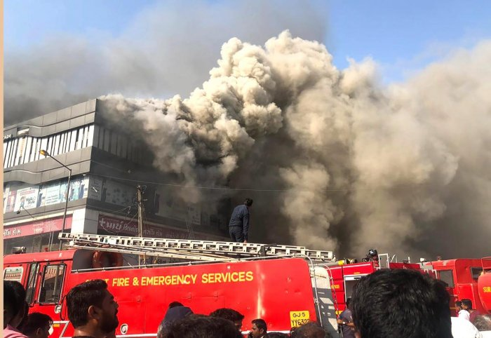 Smoke coming out from the Taxshila Complex after a fire