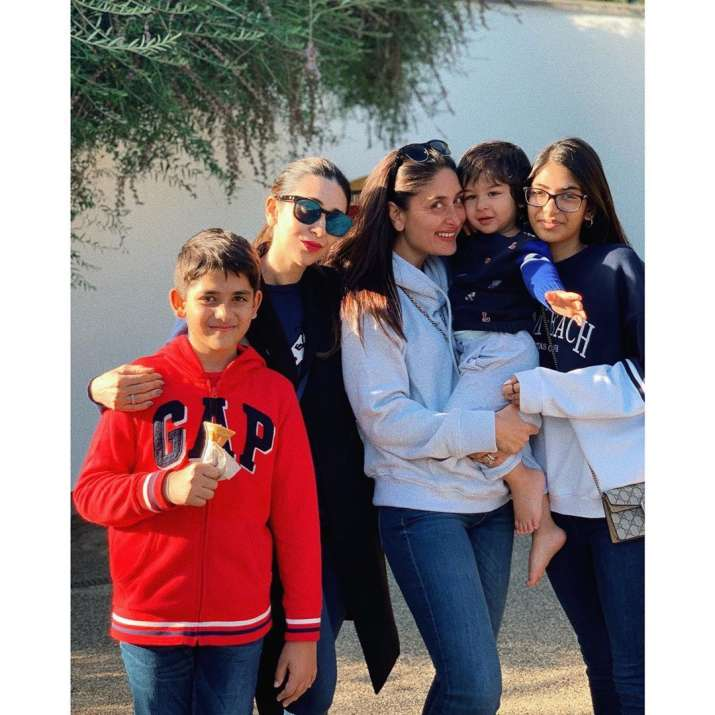 India Tv - Kareena Kapoor Khan and Karisma's daughter Samiera give bear hug to Taimur in London
