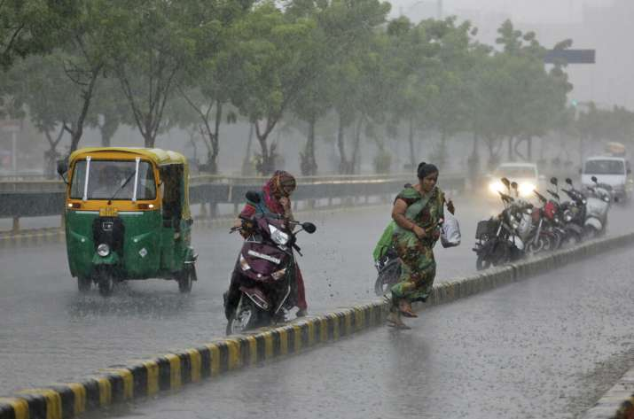 India Tv - People rush to find shelter from rains in Ahmedabad, Gujarat
