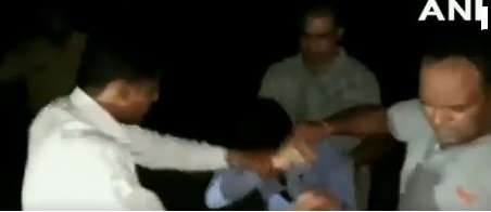 Stills from a video of the assault which is viral on social