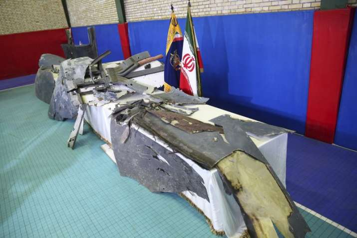 India Tv - Debris from what Iran's Revolutionary Guard aerospace division describes as the U.S. drone which was shot down on Thursday is displayed in Tehran, Iran, Friday, June 21, 2019. Major airlines from around the world on Friday began rerouting their flights to avoid areas around the Strait of Hormuz following Iran's shooting down of a U.S. military surveillance drone there, as America warned commercial airliners could be mistakenly attacked. (Meghdad Madadi/ Tasnim News Agency via AP)