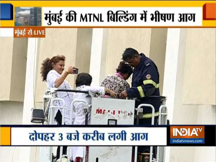 India Tv - Woman, stuck inside MTNL Building, seen making a video as she was being rescued.