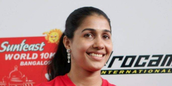 Indian long jumper Anju Bobby George takes a rest during a