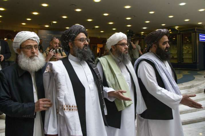 India Tv - Mullah Abdul Ghani Baradar, the Taliban group's top political leader, second from left, arrives with other members of the Taliban delegation for talks in Moscow, Russia. The seventh and latest round of peace talks between the U.S. and Taliban is
