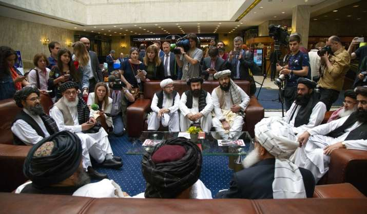 India Tv - Mullah Abdul Ghani Baradar, the Taliban group's top political leader, left, Sher Mohammad Abbas Stanikzai, the Taliban's chief negotiator, second left, and other members of the Taliban delegation speak to reporters prior to their talks in Moscow, Russia. The seventh and latest round of peace talks between the U.S. and Taliban is