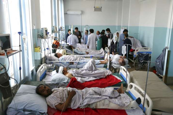 India Tv - Wounded people receive treatment in a hospital after a powerful bomb blast in Kabul, Afghanistan, Monday, July 1, 2019. A powerful bomb blast rocked the Afghan capital early Monday, rattling windows, sending smoke billowing from Kabul's downtown area and wounding dozens of people.