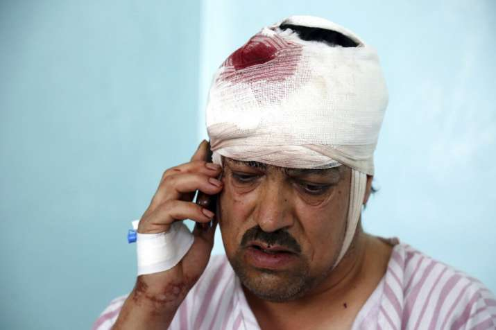 India Tv - A wounded man talks on his mobile phone after receiving treatment in a hospital following a bomb blast in Kabul, Afghanistan, Monday, July 1, 2019. A powerful bomb blast rocked the Afghan capital early Monday, rattling windows, sending smoke billowing from Kabul's downtown area and wounding dozens of people.