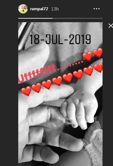 India Tv - Arjun Rampal shares the first glimpse of his son, holding his hand- See latest picture