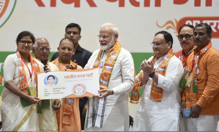 Prime Minister Narendra Modi with Uttar Pradesh Chief Minister Yogi Adityanath at the launch of BJP