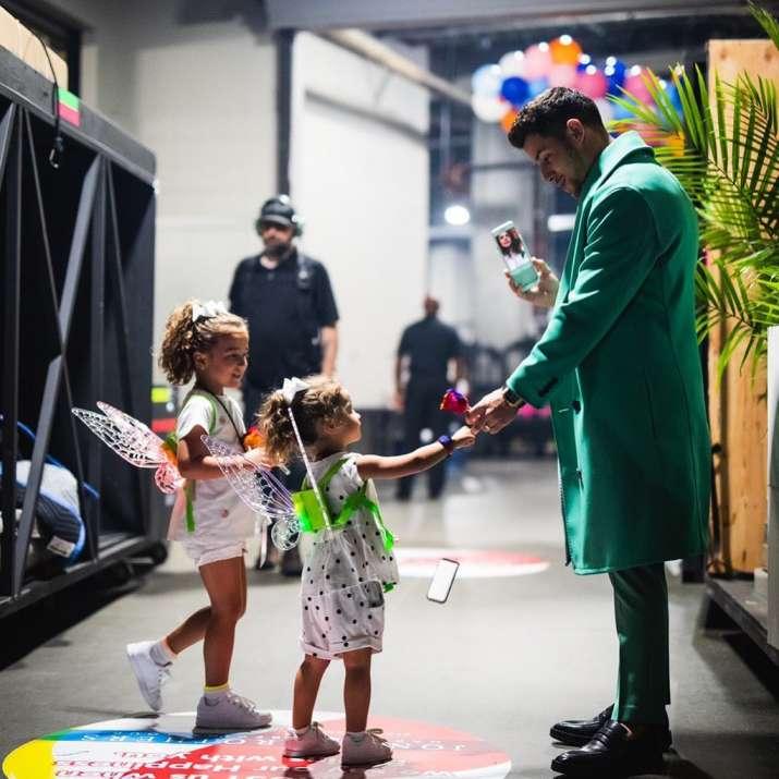 India Tv - Nick Jonas with nieces Alena and Valentina