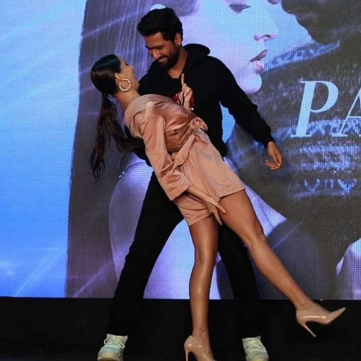 India Tv - Nora Fatehi's OOPS moment as she dances with Vicky Kaushal at Pachtaoge song success party