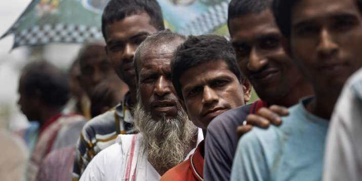 India Tv - People waiting to check their names on the final NRC list