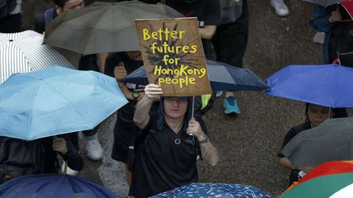 100,000 hit streets as protests continue to roil Hong Kong