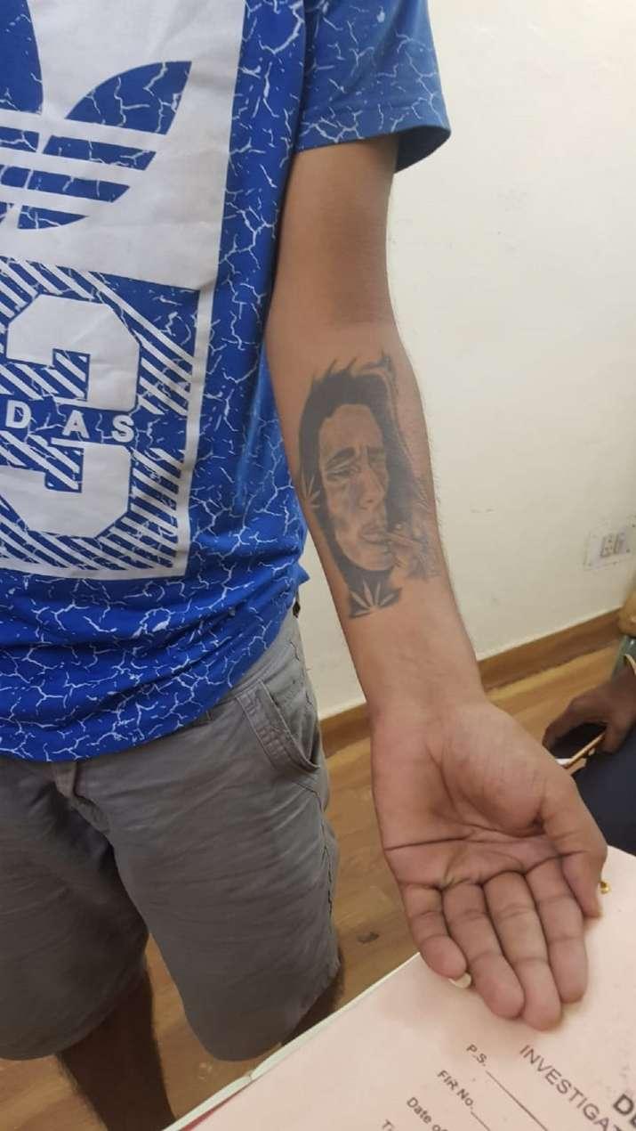 India Tv - Accused Vishal has got a tattoo of Bob Marley on his hand