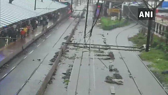 India Tv - Kalyan railway station waterlogged following incessant rain in the city