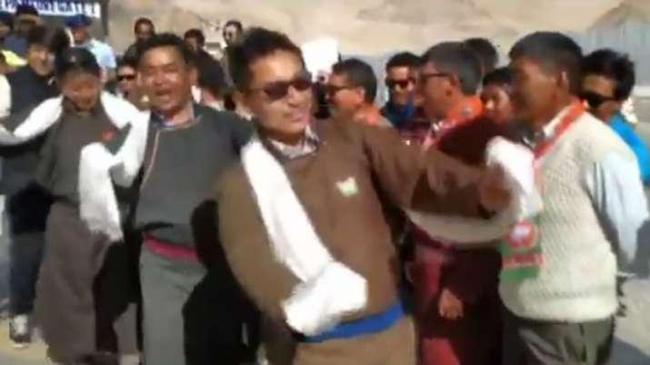 Attired in the traditional dark brown 'goucha' -- Ladakhi
