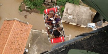 India Tv - Indian Navy conducts rescue operations in flood-hit Karnataka.