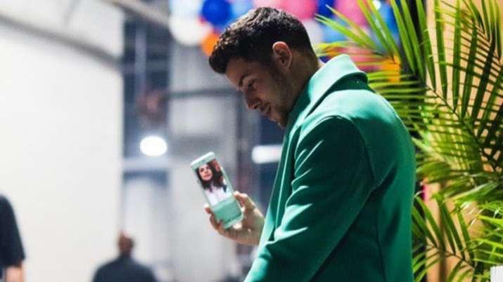 India Tv - Nick Jonas on video call with wife Priyanka Chopra
