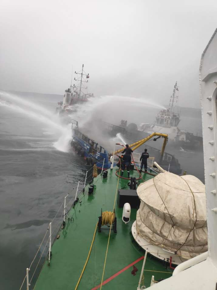 India Tv - Rescue ships and boats were rushed to coastal vessel Jaguar that caught fire earlier today in Vizag.