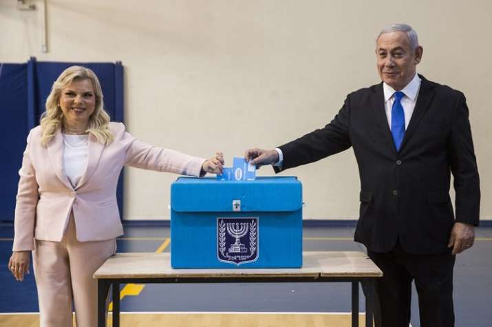 India Tv - Israeli Prime Minister Benjamin and his wife Sarah casts their votes at a voting station in Jerusalem