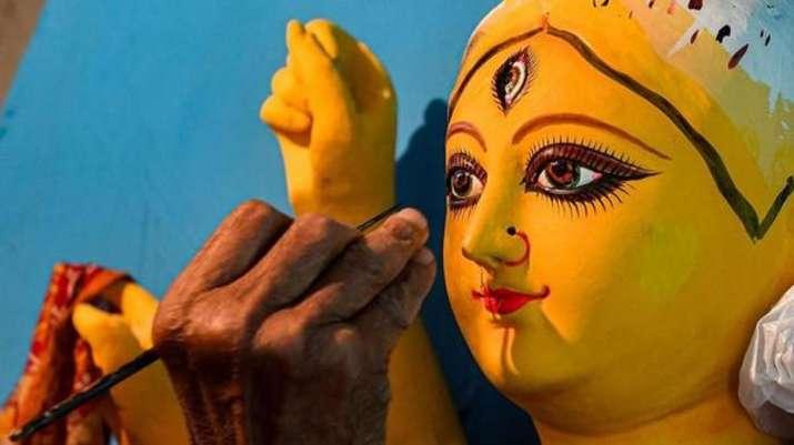 Devi Durga to click photos, LGBT people draw graffiti in Kolkata puja