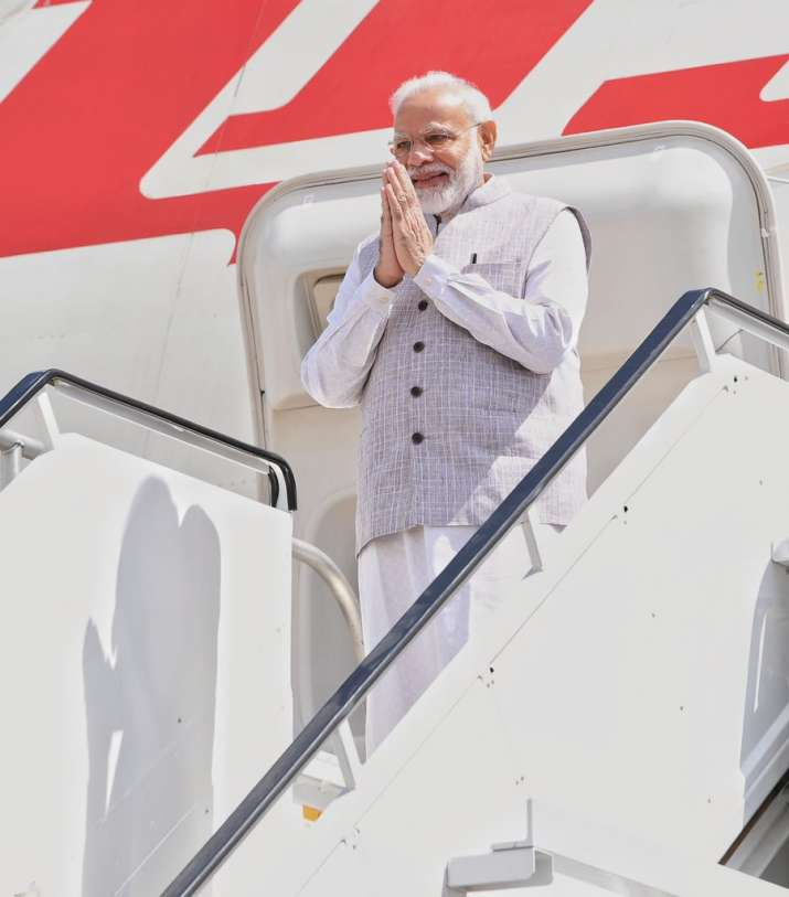 India Tv - Modiji getting down from the airplane at the Houston.
