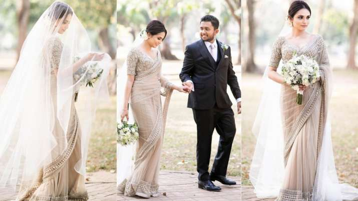 This real bride wore a Sabyasachi saree with a veil on her