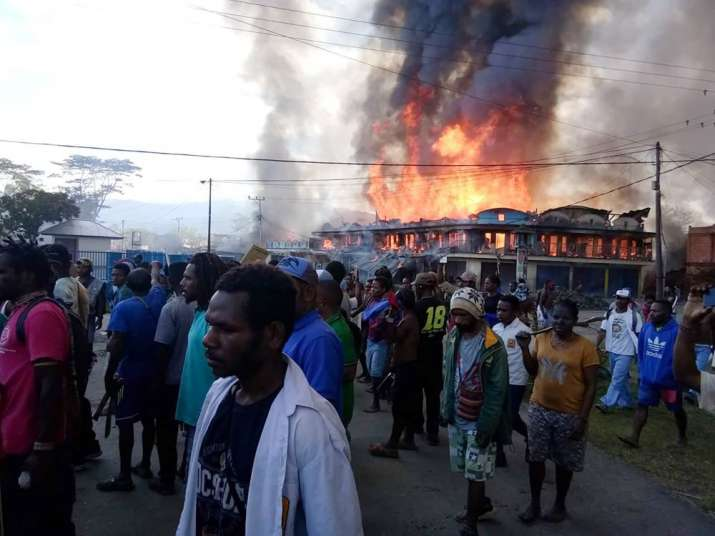 An angry mob torched local government buildings, shops and