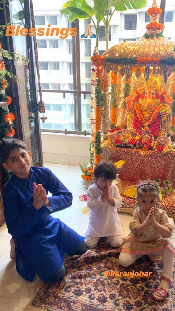 India Tv - Taimur and Roohi offering prayer to Lord Ganesha