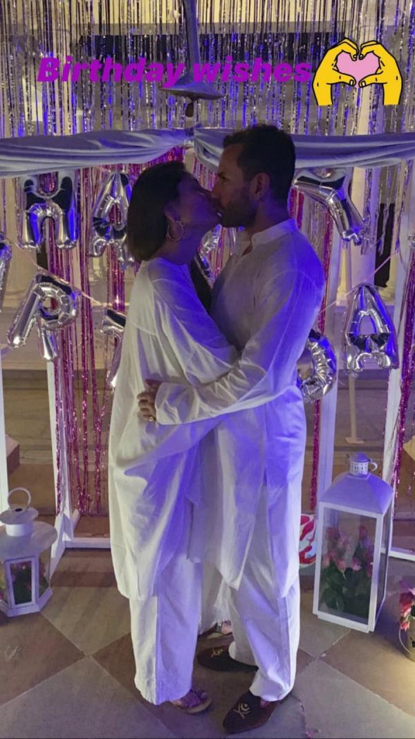India Tv - Kareena Kapoor and Saif kiss each other