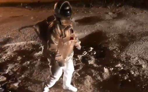 'Astronaut' doing the moonwalk on Bengaluru potholes