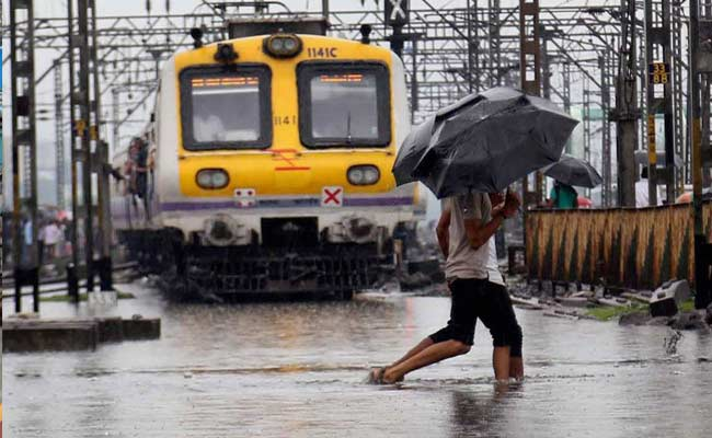 Mumbai Rains Local Train Status delayed cancelled flight
